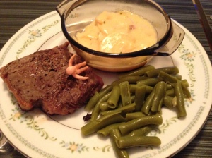 Half of my New York Strip with some scalloped potatoes and green beans