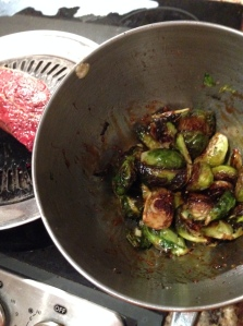 Tossing brussel sprouts in a teriyaki glaze